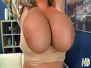 Vulgar Anna Kay with unnaturally big tits puts guy's dick inside her
