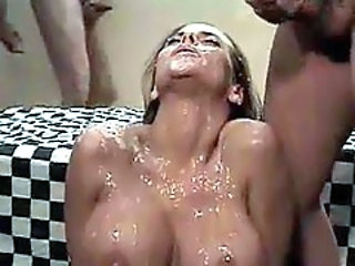 Cocks cover her face and tits with jizz