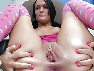 Dark haired babe fists her gaping gash hole after getting it cleaned
