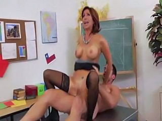 Horny MILF teacher in black stockings gets fucked in the classroom