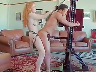 Mean mistress puts on a strap-on and shoves up her slaves ass