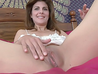Brunette housewife brings herself to orgasm with a vibrator
