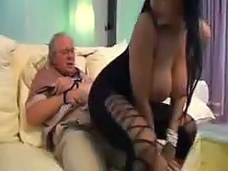 Old man has hands bound as she blows him