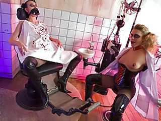 This video presents gothic bitches Franki and Tammy clad in latex and patent leather indulging in filthy sex in the dentist's office! Inflatable cock deep up in the asshole is obviously what gives them a great kick! C'mon in and get to see how they find n