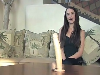 gorgeous brunette and her dildo