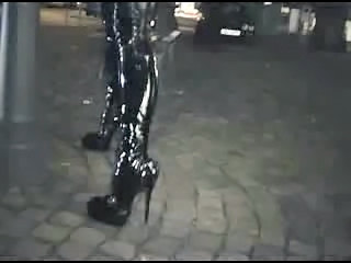 Fetish Latex Catsuit and platform Boots at Night in Public