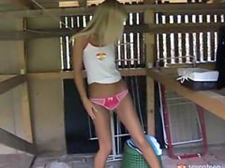 Blonde girl in the barn