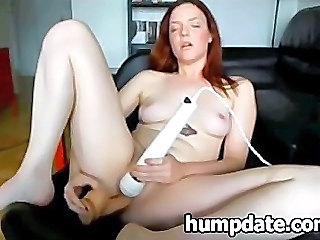 Sexy redhead toying her pussy...