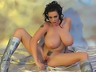 Busty British MILF fucks herself with a dildo