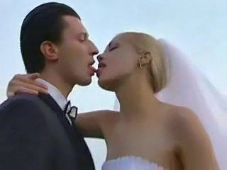 Blonde Bride Kissing