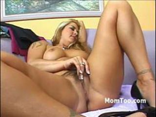 Innocent looking blonde pussy licked while mommy masturbates