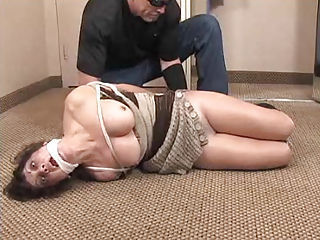 Tied up bitch gagged and recieves some brutal bdsm