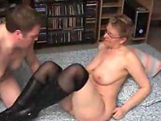 Mature in black boots banged