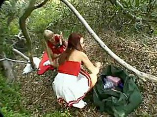 Cheerleaders in the woods sharing dildos