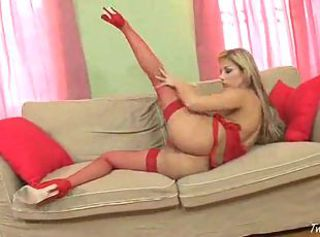 Luxurous blonde in red rubbing and fingering her wet shaved kitty