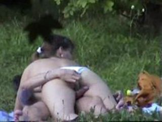 Voyeur clip of couple fucking in a field