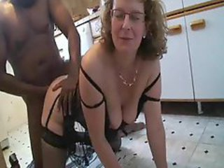 Mature bitch gets black cock in the kitchen