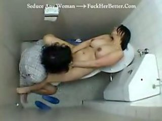 Asian nurse with the addition of cleaning lady help a patient jerk off