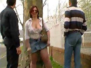 French milf fucked outdoors by two guys