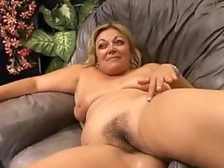 Hairy granny is getting the young cock hard
