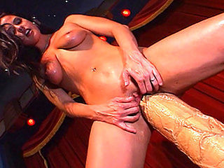 Brunette with massive sex toy