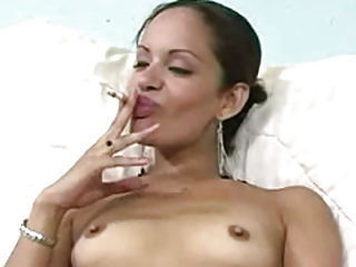 Sexy little whore blows smoke on her clit and cums
