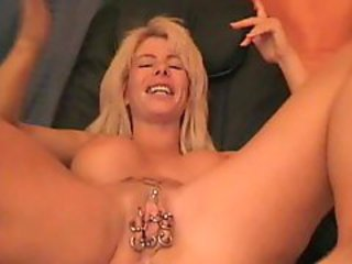 Extremely Pierced MILF Pussy Is Beeing Used