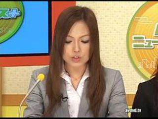 Japanese newsreader Ayumu Sena together with Fuuka Minase squir...