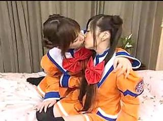 Japanese girls in costume kiss and play