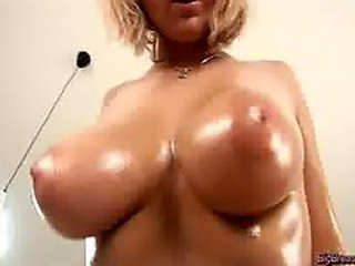 Oiled Blonde With Huge Breast Fingering Cunt