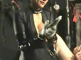 Mistress in black latex catsuit fist fucks with both hands while eradicate affect slave gave himself a handjob