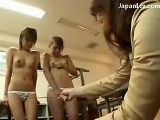 2 Schoolgirls In Uniform Forced To Kiss Each Other Getting Undressed By The Teacher In The Classroom