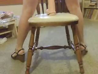 Riding A Huge Dildo On The Chair