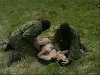 Young brunette mistreated in the forest by guys in masks