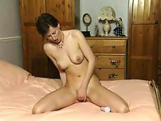 British MILF in boots plays with a dildo