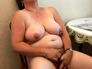 Chubby bitch with big tits plays solo