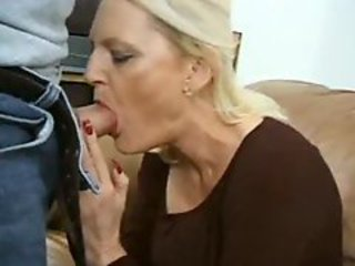 Double teaming a mature blonde slut