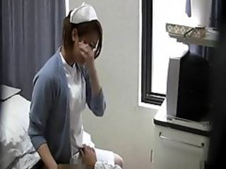Japanese nurse jerking cock on hid cam