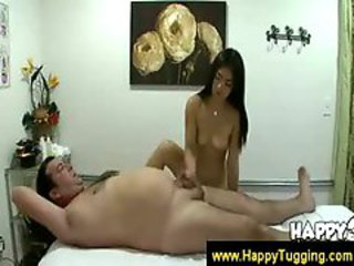 Asian masseuse tugging her clients boner