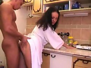 Couple has morning sex on kitchen table