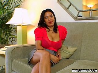 Alluring milf Sienna West looks smokin hot on the couch dirty talking to tease