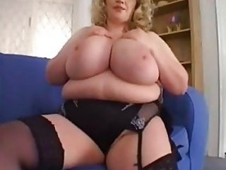 Huge tits fat girl plays with her body