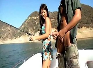 Sexy Asian Girl Learns How To Fish