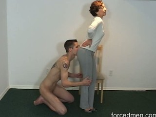 Naked slave licks fuzz ball poppet legs...