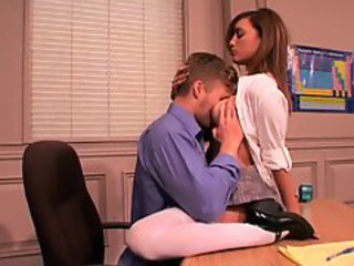 Melanie Janes teacher gives her a lesson on his desk
