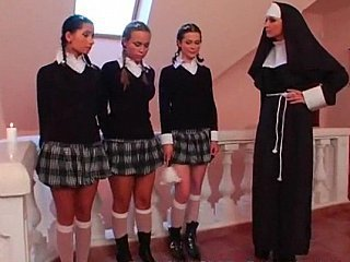 Duo schoolgirls with the addition of a Nun