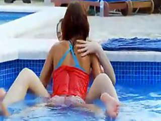Slim lezzies enjoy water & teasing in the pool