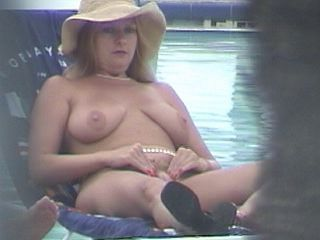 Nude Blonde Spreads Pussy Lips to hand Pool