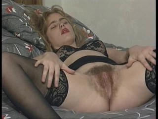 British hairy floosie plays with...