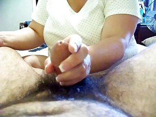 Mature wife footjob increased by handjob